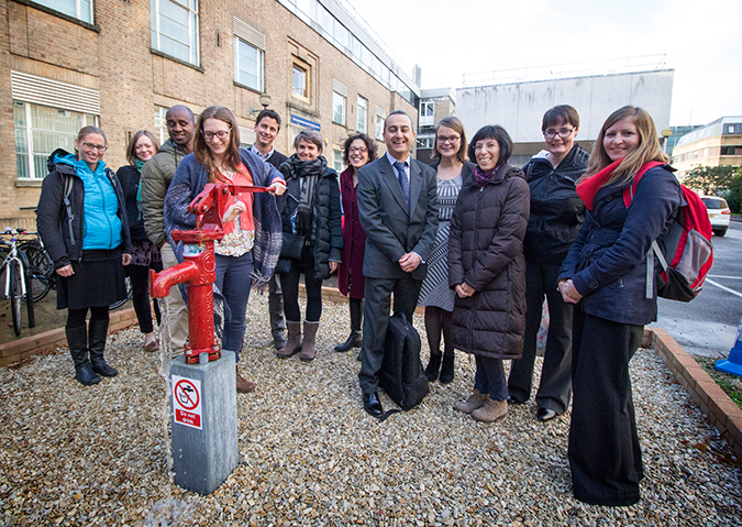Pumping the Smart Handpump outside the School of Geography and the Environment