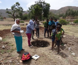 Local observers monitoring shallow groundwater in Ethiopia (credit: David Walker)