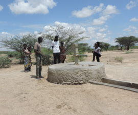 Florence at Kakemera Community handpump (May 2018) | Documentation of groundwater sources and their hydrogeological setting in the Lodwar area allows for a detailed understanding of their operational, water quality and pollution status, and the potential for resource development