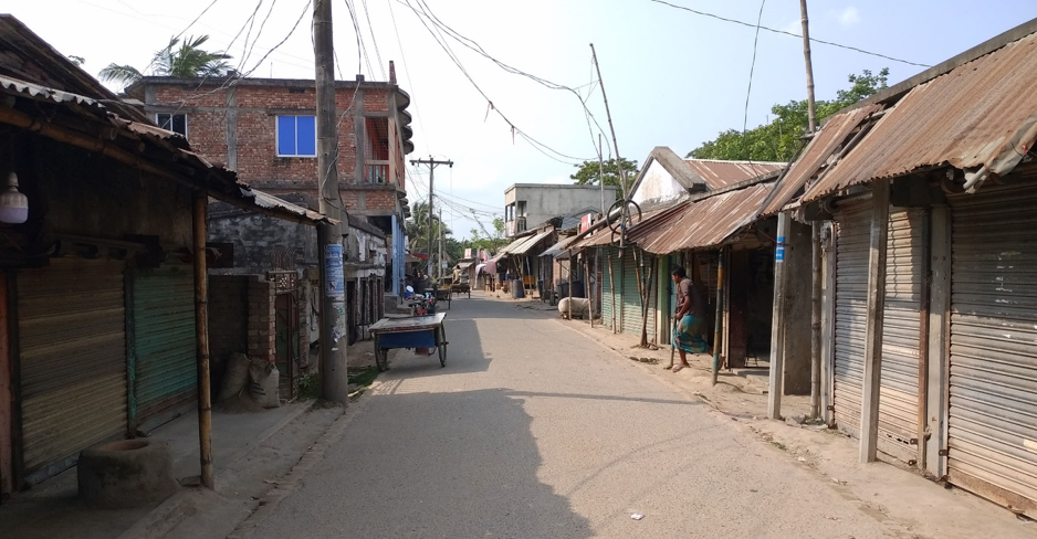Empty road and closed shops in Polder 29, Bangladesh. Credit: Lutfor Rahman