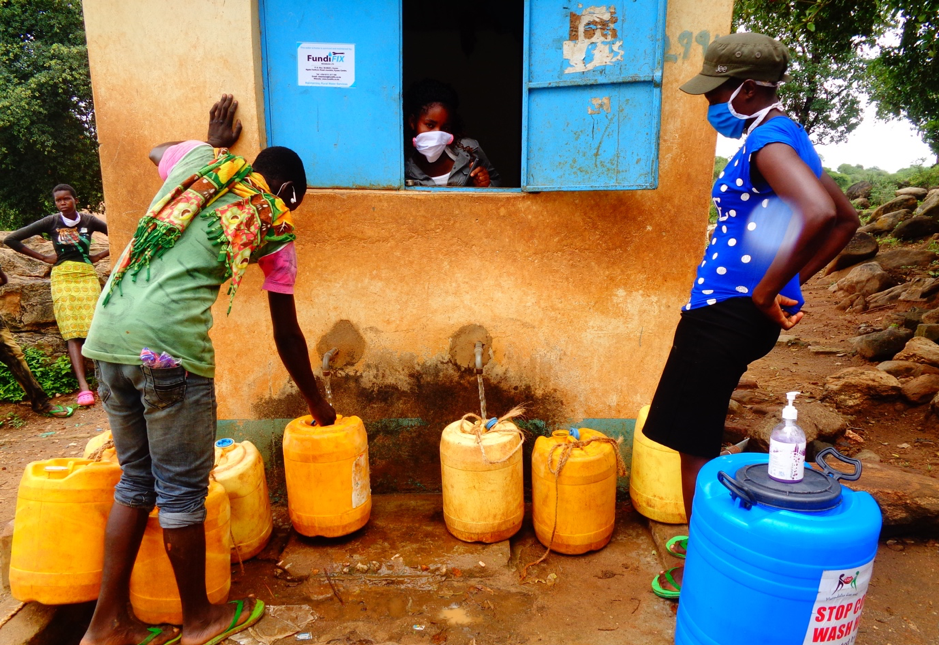 Water collection at a kiosk in Kitui, Kenya, during the COVID19 pandemic. April 2020; Credit: Mary Musenya Sammy