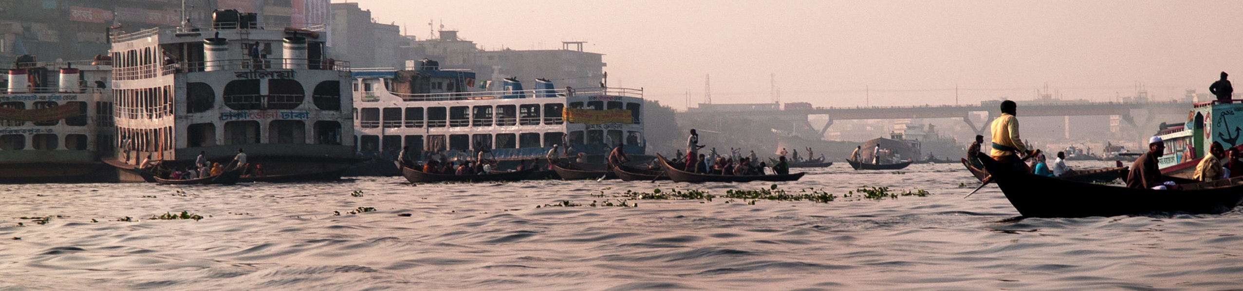 Boats over the Turag river in Dhaka; Credit: Suc/istock image;