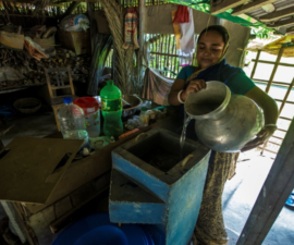 Woman storing water in Satkhira; photo credit: COAST