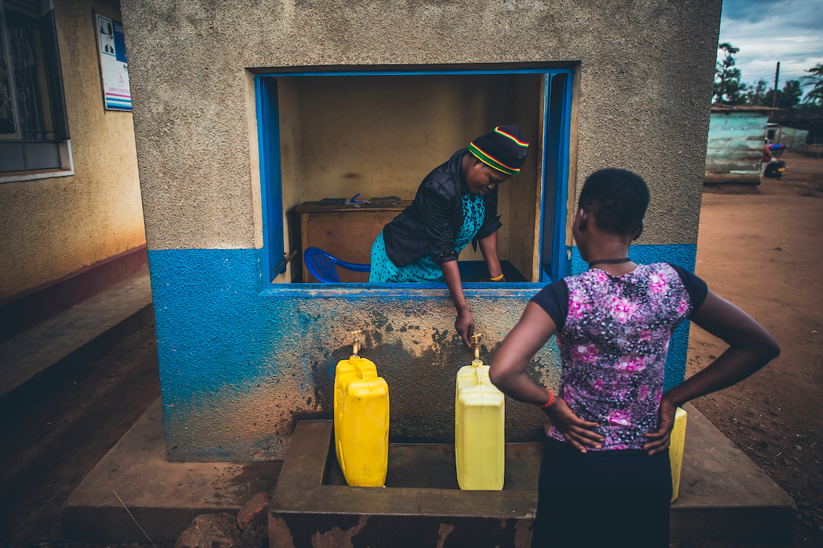 A girl collects water from a kiosk in Uganda prior to the COVID-19 pandemic (Photo courtesy of Water Mission)